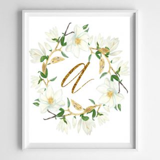 "The letter ""a"" in gold with white flowers drawn around it"