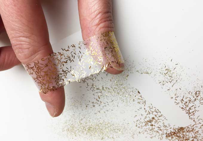 easily clean up glitter using tape or a lint roller