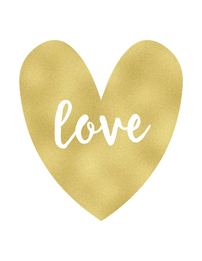 """A gold heart with \""""love\"""" written in white cursive in the middle of the gold heart"""