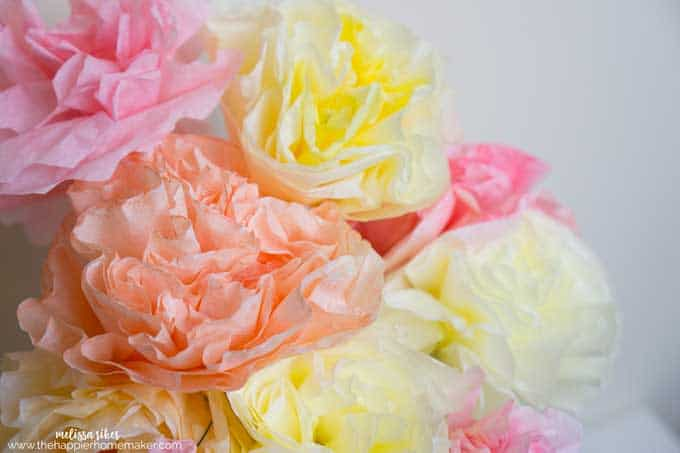 A collage of yellow, orange and pink coffee filter roses