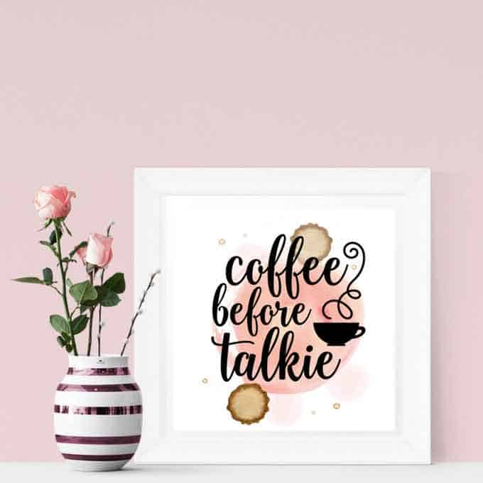 A vase with flowers in it next to printable reading coffee before talkie