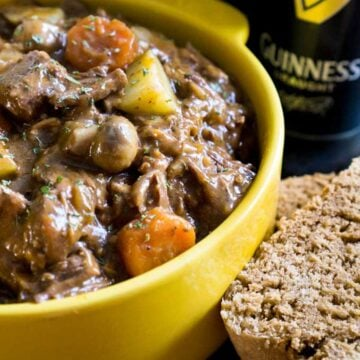 guinness beef stew in yellow bowl