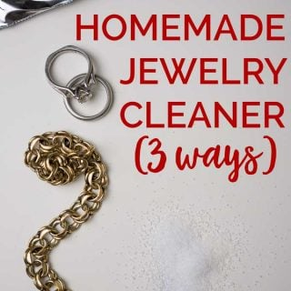 "A brass bracelet and platinum wedding rings on white paper with the words ""Homemade Jewelry Cleaner (3 ways)"""