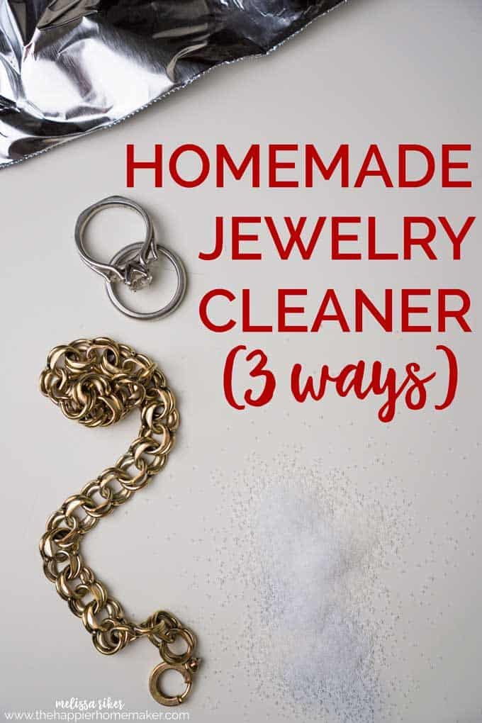 "A brass bracelet and platinum wedding rings on white paper with the words ""Homemade Jewelry Cleaner (3 ways)\"""
