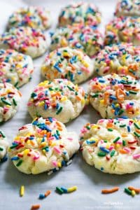 Funfetti Cookies with sprinkles on parchment paper
