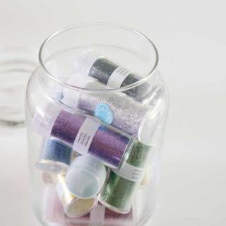 jar with vials of glitter