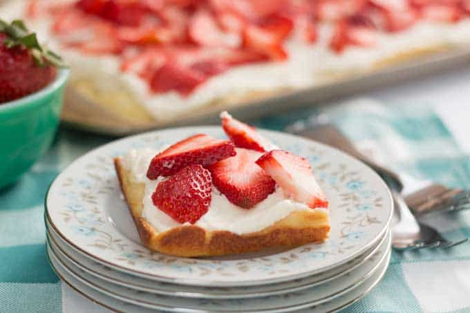 Strawberry Cream Puff Cake is an easy recipe that is delicious and beautiful enough for entertaining. Perfect for summer picnics and parties!