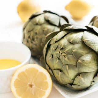 How to cook an artichoke. Once you try a steamed artichoke you'll be converted-this is one of my favorite vegetable recipes to make! (If you can even call it a recipe!!)