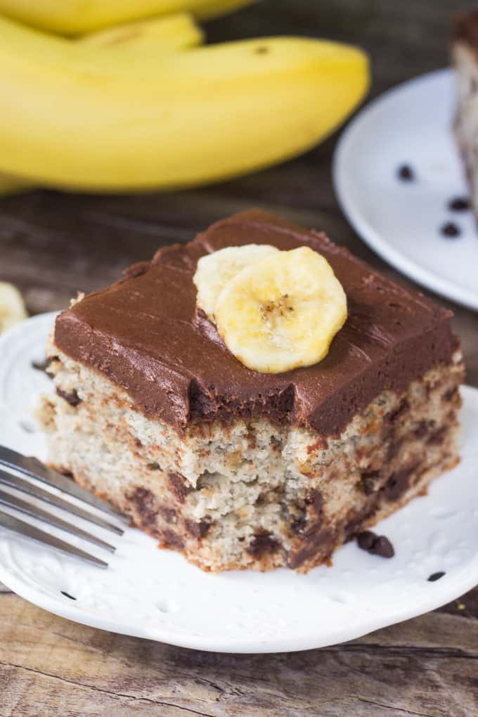 This Chocolate Chip Banana Cake with Chocolate Frosting is filled with big banana flavor, super moist & dotted with chocolate chips! The best way to use up those brown bananas!