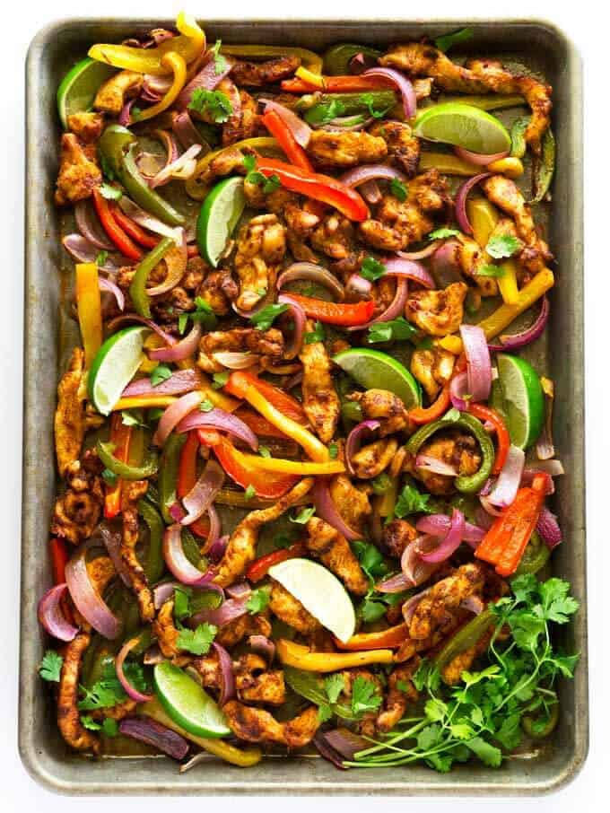 These one pan chicken fajitas are oven roasted to perfection in under twenty minutes. They are delicious, quick, and easy to throw together!