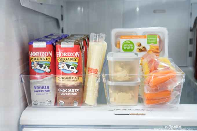 A refrigerator filled with food for lunchboxes