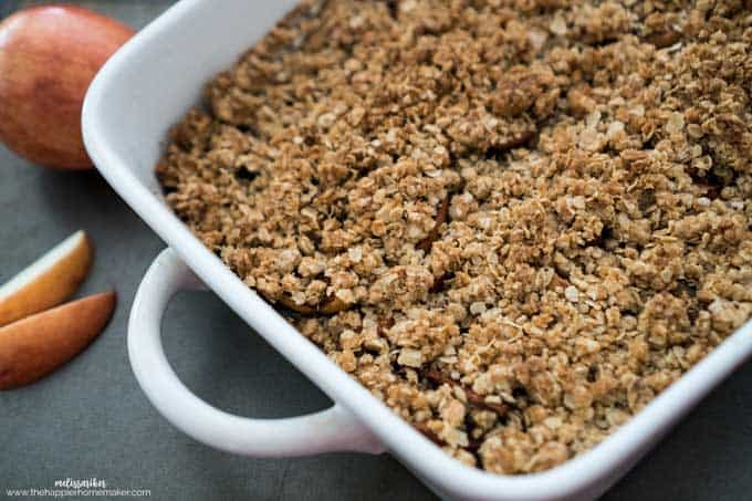A white baking dish filled with apple oatmeal crisp