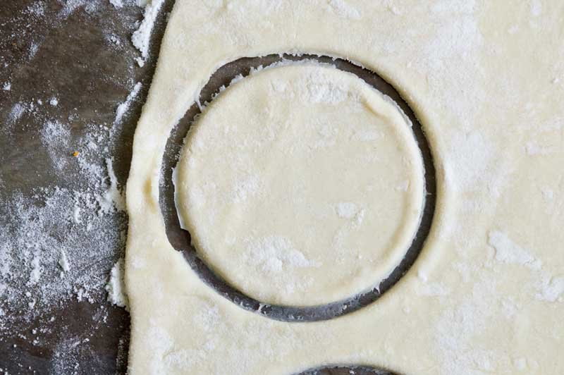 puff pastry dough cut into a circle with biscuit cutter