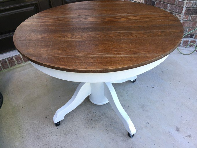 A round wooden table with white base
