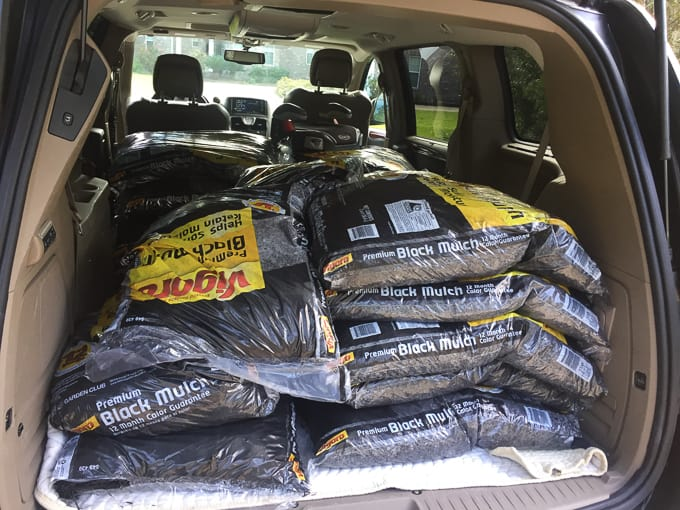 bags of mulch in the back of a minivan