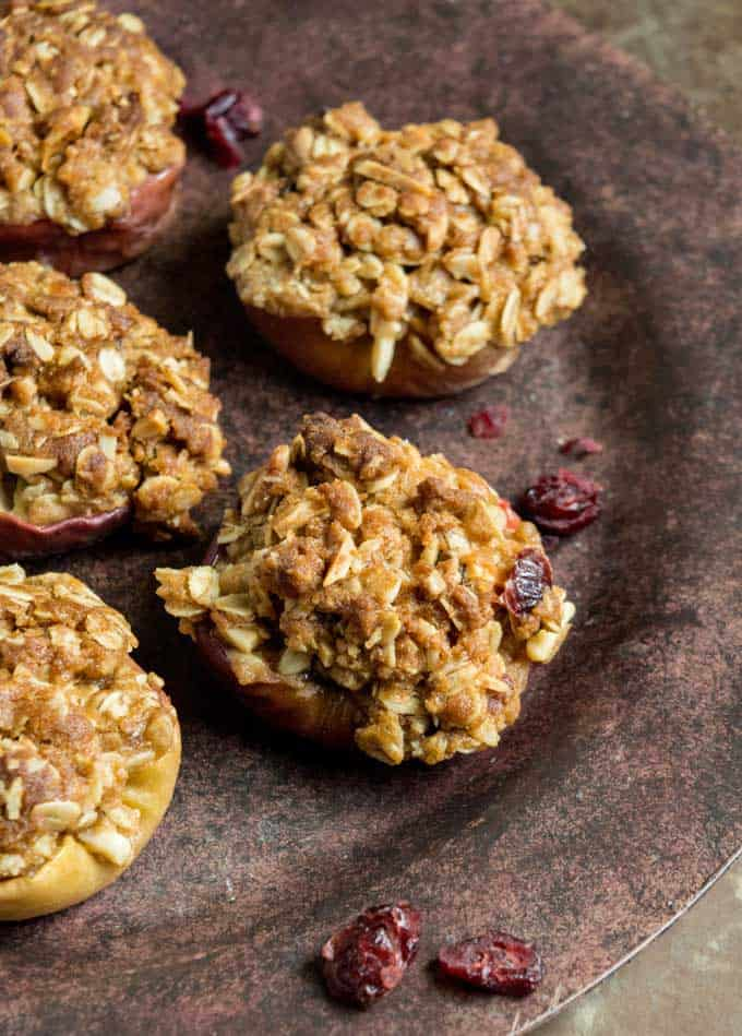 Easy Baked Apples are the perfect autumn dessert recipe-apples topped with a fruit and nut filled oatmeal crisp topping, perfect alone or with ice cream!