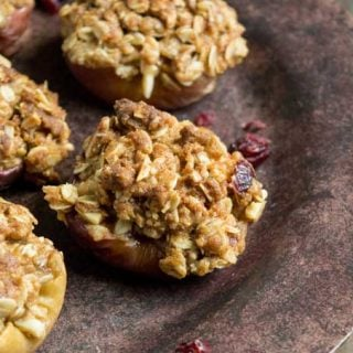 A close up of baked apples with oatmeal crisp