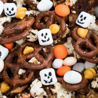 A collection of pumpkin spice snack mix with M&Ms, marshmallows and pretzels