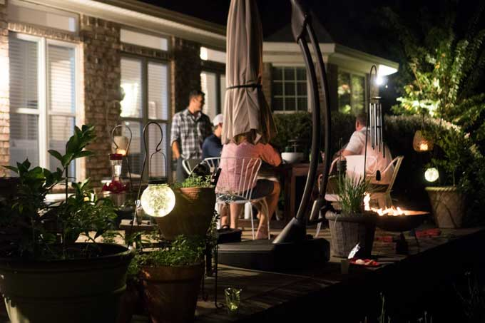 outside patio with people talking at night