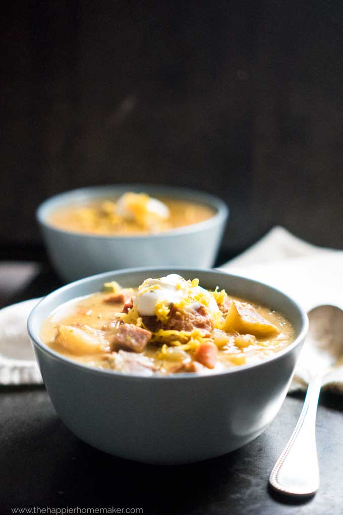Cheesy Bacon Ham Potato Soup in blue bowl