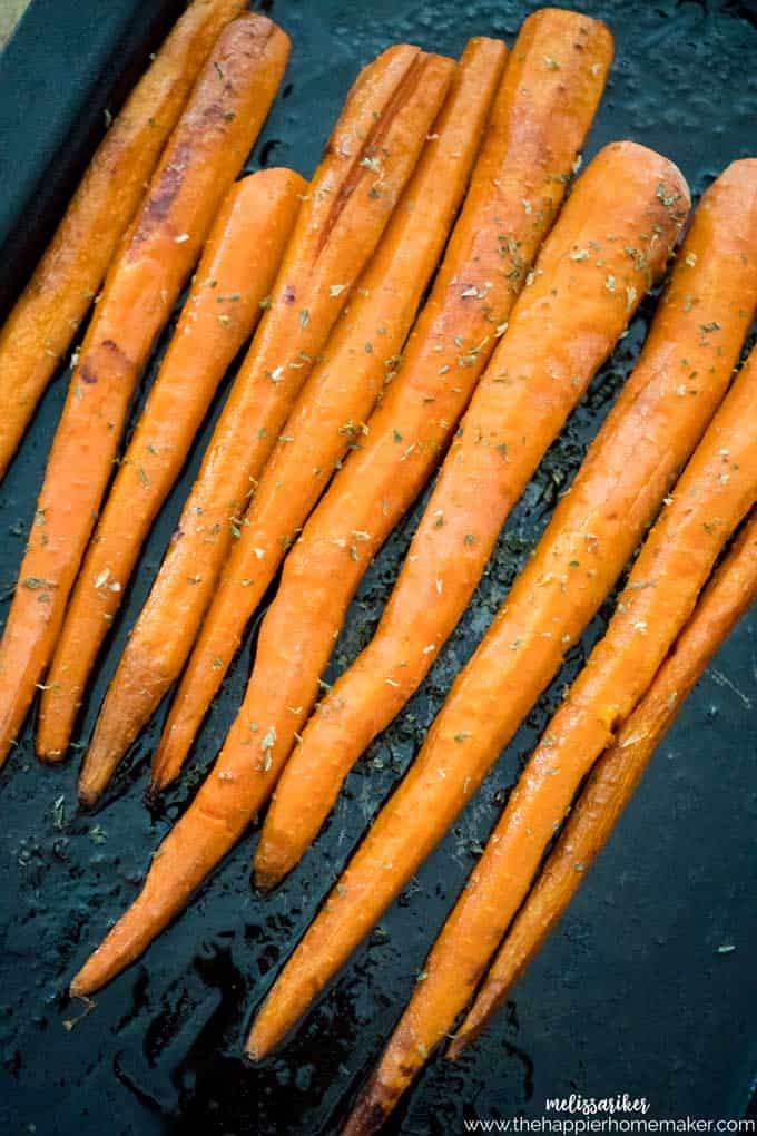 Maple butter roasted carrots on baking sheet