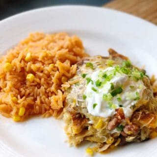 A close up of green enchilada casserole on a plate