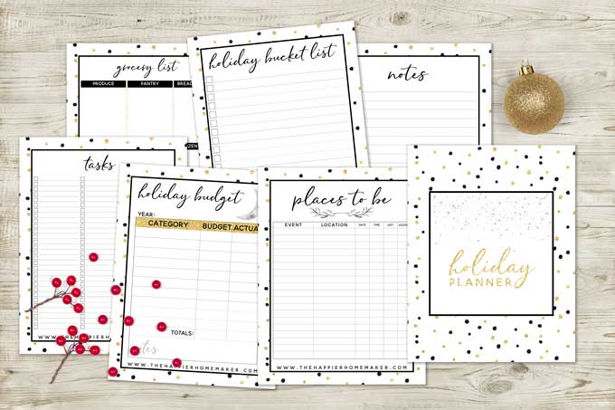 holiday planner sheets laying on wood surface
