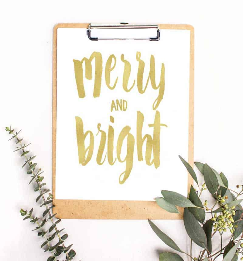 A close up of a sign that says Merry and Bright