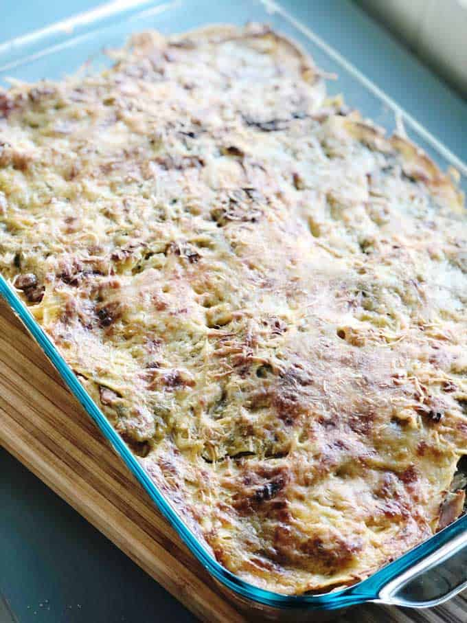 Easy, cheesy Green Enchilada Casserole is a delicious family friendly weeknight dinner recipe!