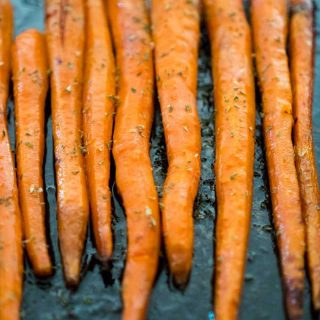 Maple butter roasted carrots are super easy, just 3 ingredients, and a huge hit every time I serve them. Tender roasted carrots with the sweetness of maple syrup!