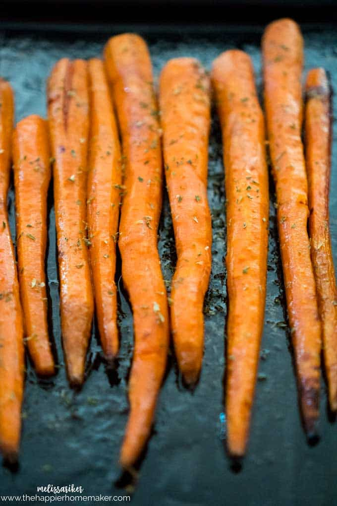 Maple butter roasted carrots on baking pan