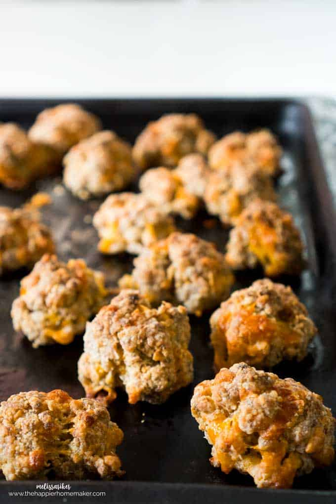 A close up of sausage cheddar balls on a baking tray
