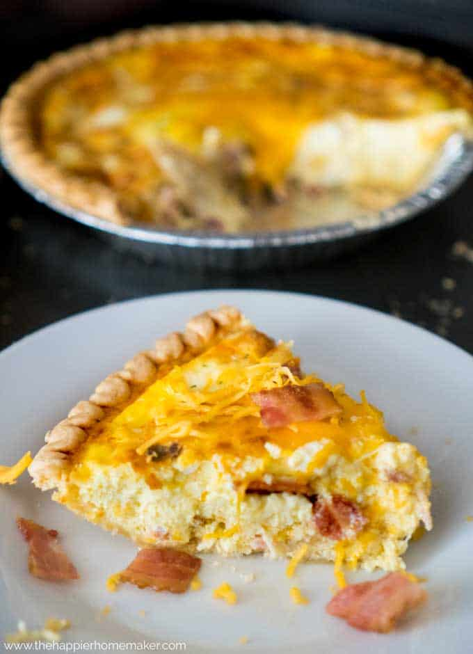 Hearty Bacon Cheddar Quiche pulls together in a snap and is perfect for brunch or potluck dinners! Made in a deep dish pie crust, it is always a hit!