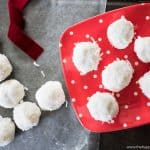 Gluten free Coconut Snowballs are the perfect dessert recipe to take to holiday gift exchanges. Only 3 ingredients and allergy & intolerance friendly.