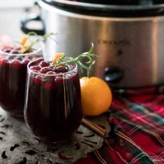 Slow Cooker Mulled Wine is a classic winter drink recipe perfect for entertaining at those holiday parties! Inspired by the British Christmas Markets!