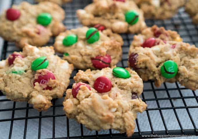 A close up of chocolate chip cookies with green and red M&Ms