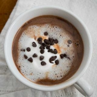Nutella Hot Chocolate in ahitw mug with whipped cream and chocolate chips