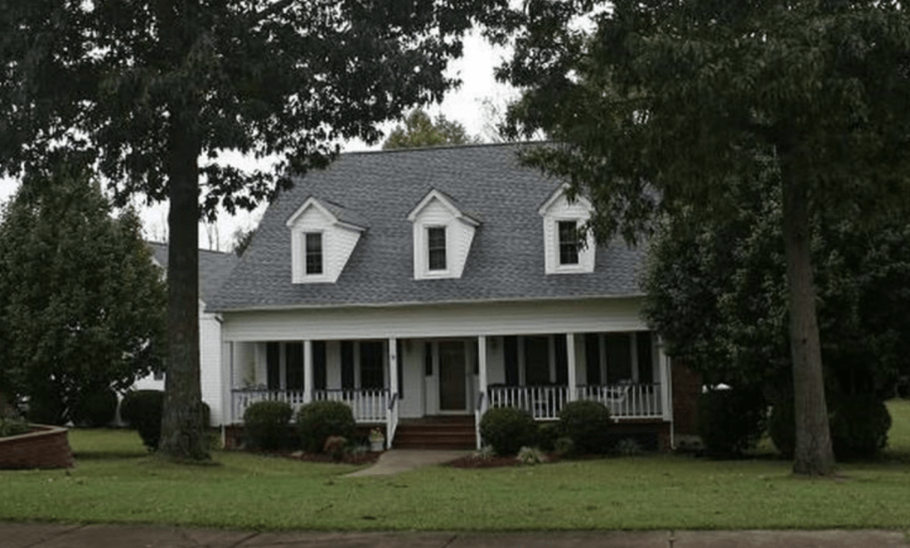white two story home with porch