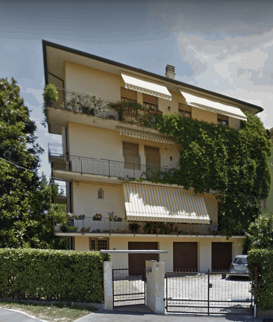 apartment building in Italy with vine growing on side