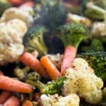 A close up of roasted vegetables including broccoli, cauliflower and carrots