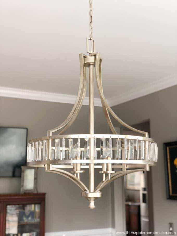 Dining room with painted and lighting update, I love this glass and mercury glass chandelier!