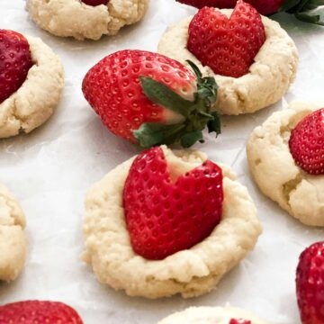 cookie with heart shaped strawberries on top