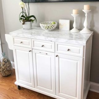 white rolling kitchen island with marble top