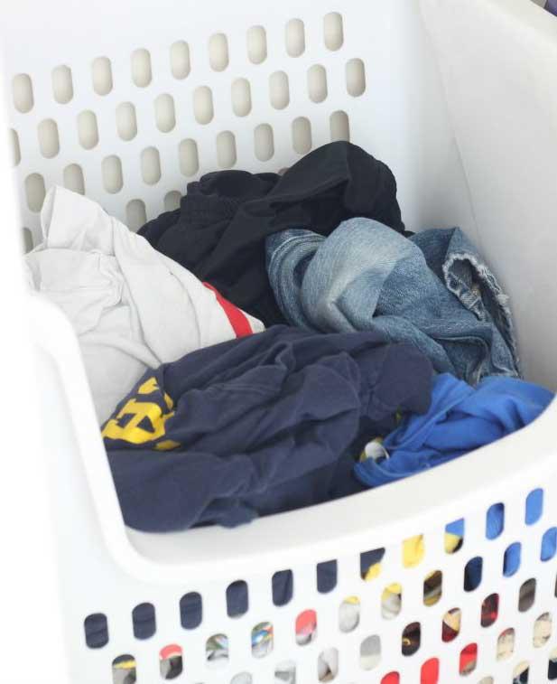 clothes in a white hamper