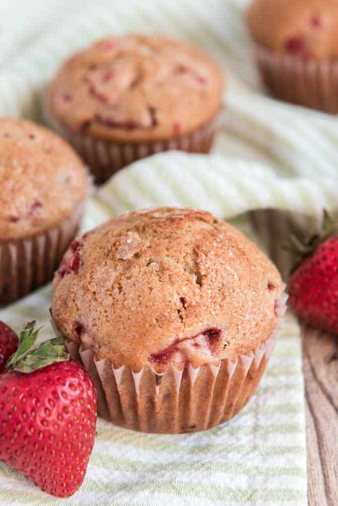 homemade strawberry muffins on green napkin