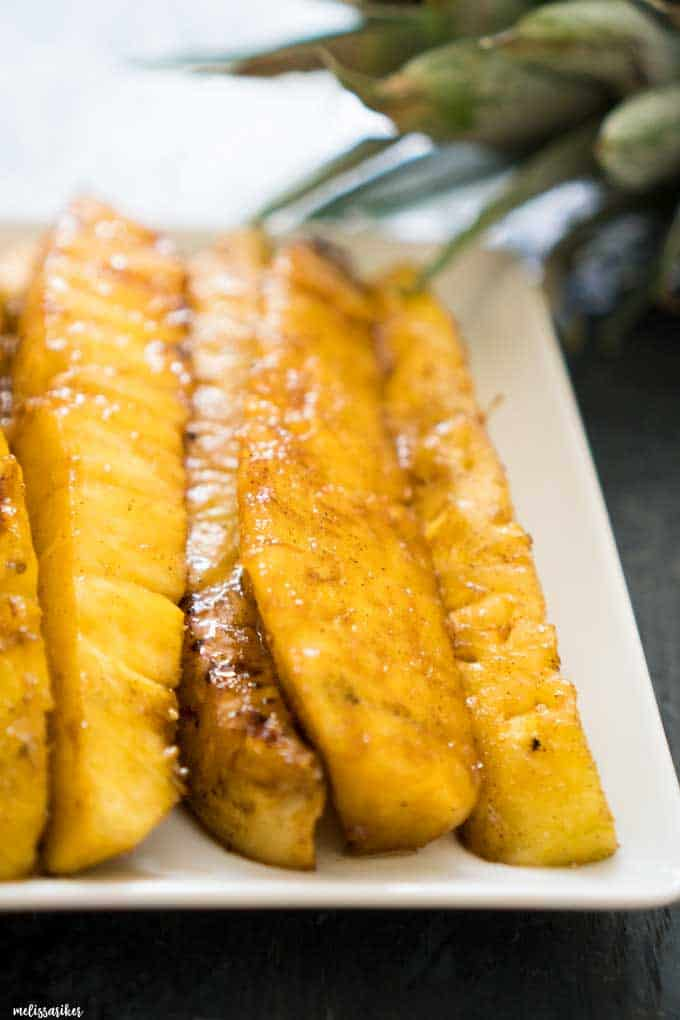 brown sugar grilled pineapple spears on white plate