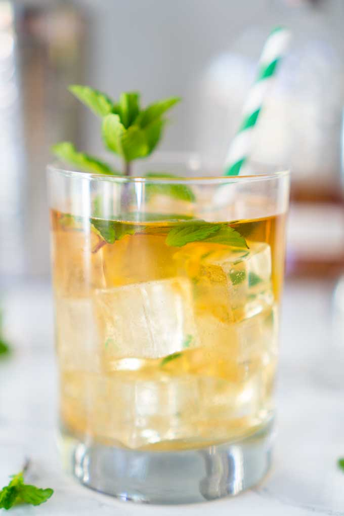 A close up of a Mint julep in a glass