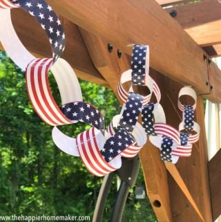 patriotic paper chain with stars and stripes hanging from wood pergola