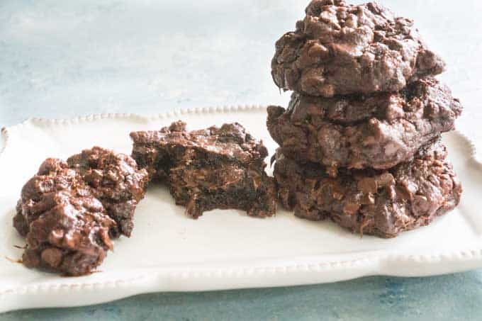 close up of chocolate cookies on white plate