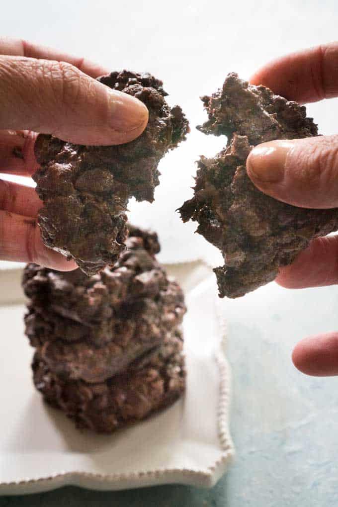 chocolate cookie being broken in half